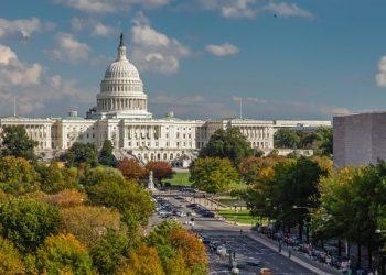 View down Pennsylvania Avenue toward the West Facade of the U.S. Capitol Building in Washington, DC. Autumn Season.